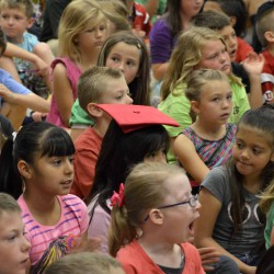 College assembly stresses importance of high school graduation, higher education prep
