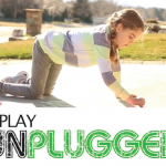 Play Unplugged logo with photo of girl drawing with sidewalk chalk on pavement.