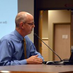 Photo of administrator presenting report during board meeting