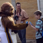 Photo of Utah Jazz mascot giving prize to student