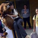 Photo of Utah Jazz mascot lifting Spring Lane teacher