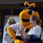 Photo of Salt Lake Bees mascot posing with parent