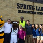 Photo of Utah Jazz and Salt Lake Bees members posing in front of Spring Lane Elementary