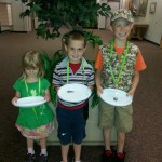 Photo of three kids with Play Unplugged prizes
