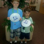 Photo of two students with Play Unplugged prizes