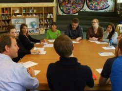 Photo of parents gathered around a round table