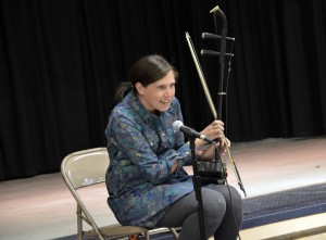 Photo of teacher displaying instrument at Spring Lane Elementary