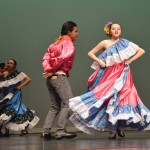 Photo of four students performing Mexican dance