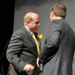 Photo of Cyprus High Hall of Fame inductee shaking hands with principal