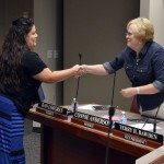 Photo of teacher shaking hands with board member
