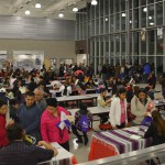 Photo of families visiting tables during Latino Family Night