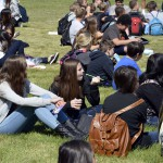 Photo of Bonneville students eating lunch on grass