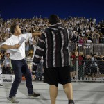Photo of superintendent throwing t-shirts to Olympus students