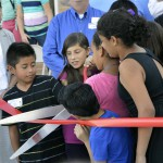 Photo of Stansbury student leaders cutting the ribbon to their new building addition