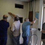 Photo of volunteers painting Kearns Jr. High classroom