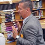 Photo of volunteer sorting Kearns Jr. High library books