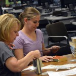 Photo of volunteers sorting Kearns Jr. High library books