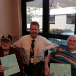 Photo of Driggs Elementary principal with two veterans