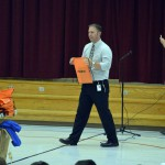 Photo of Jackling Elementary principal holding donated bag