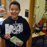 Photo of Oakridge Elementary student holding sports tickets