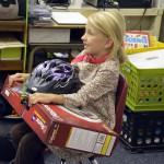 Photo of Oakridge Elementary student holding Walk More in Four prizes