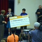 Photo of West Kearns students holding giant check