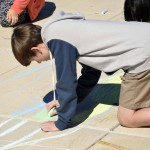 Photo of Wasatch Jr High students drawing with sidewalk chalk