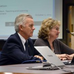 Photo of two administrators addressing board of education