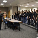 Photo of Cottonwood High Madrigals performing during board meeting