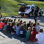 Photo of police officer addressing Eastwood Elementary students