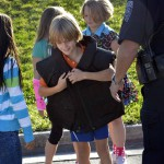 Photo of Eastwood student trying on police vest
