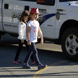 Photo of Eastwood Elementary students walking next to police vehicle