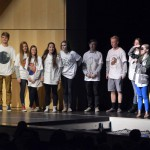 Photo of Olympus High students standing on stage