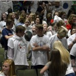 Photo of Olympus High students standing in auditorium
