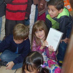 Photo of Orchard Elementary students receiving gifts from Chevron