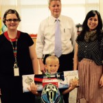 Photo of Wright Elementary student holding Walk More in Four prizes