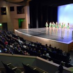 Photo of kindergarten students watching Olympus High dancers