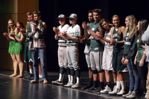 Photo of Olympus High students clapping on stage