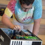 Photo of Hunter High student fixing computer