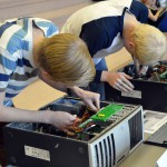 Photo of Hunter High students fixing computer
