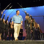 Photo of Cyprus High Hall of Fame inductee walking on stage