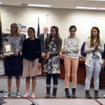 Photo of Olympus girls tennis team being recognized at board meeting