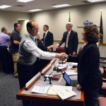 Photo of classified employees shaking hands with board members