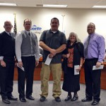 Photo of classified employees being honored during board meeting