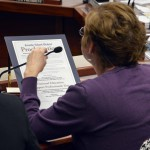 Photo of board member reading proclamation