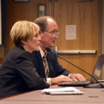 Photo of two administrators addressing the board of education