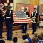 Photo of Taylorsville JROTC members handling American flag
