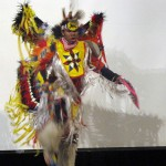 Photo of student performing Native American dance