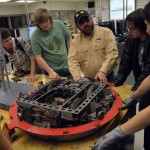 Photo of Hunter High Robotics Club members with donated robot