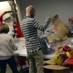 Photo of volunteers assisting with Granite Education Foundation's Santa Sacks